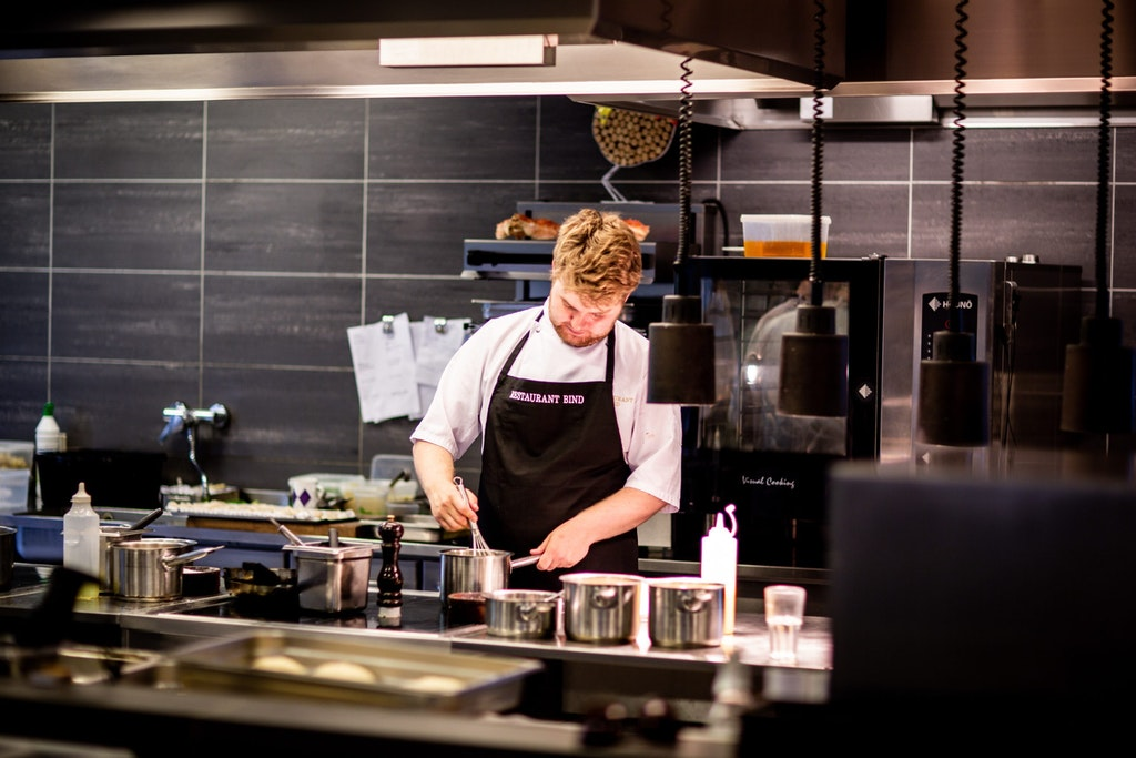 chef cooking in a restaurant kitchen